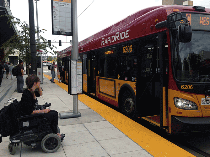 Wheelchair user boarding a bus