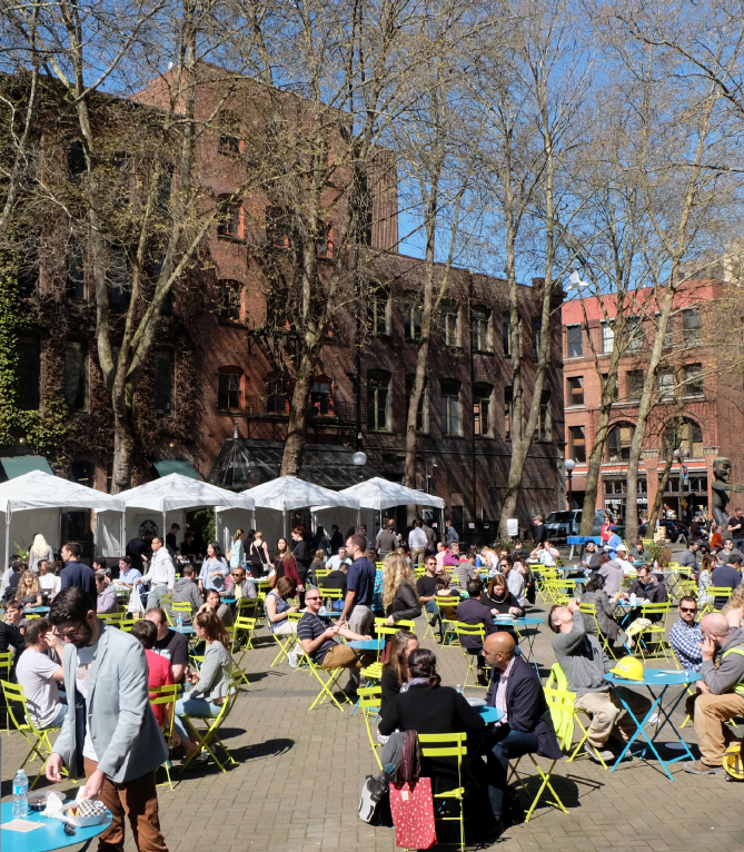 People at Occidental Park in Pioneer Square